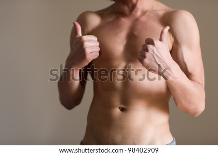 Athletic body of a man with natural light - stock photo