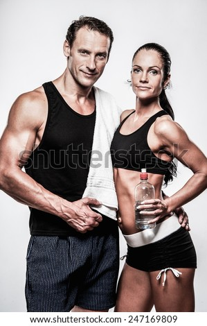 Athletic couple after fitness exercise