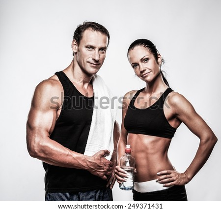 Athletic couple after fitness exercise - stock photo