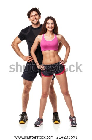 Athletic couple - man and woman after fitness exercise on the white background - stock photo
