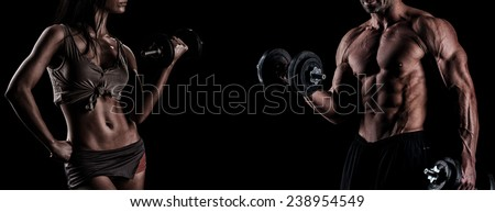 athletic couple poses for the camera - stock photo