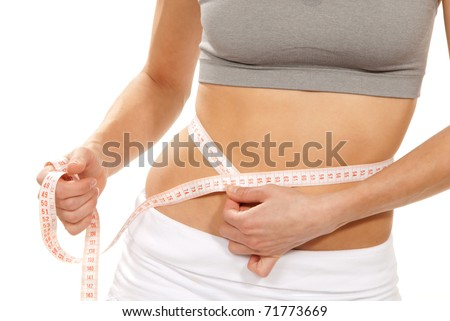 Athletic fit slim female measuring her waist metric tape measure after a diet  isolated over white background - stock photo