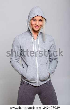 Athletic fitness woman in grey hoodie. - stock photo