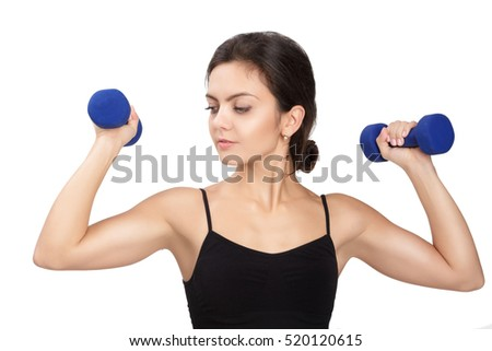 Athletic fitness woman lifting blue dumbbells on white background. diet and sport