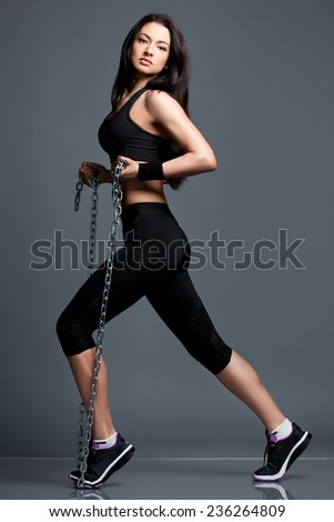 Athletic girl in sport clothes - stock photo
