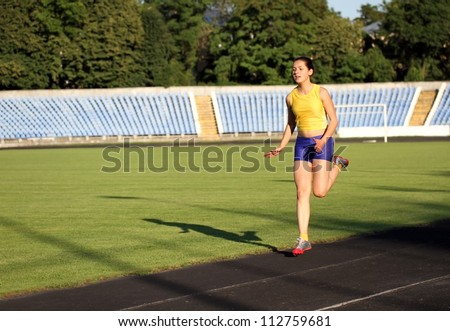 Athletic girl on the track . - stock photo