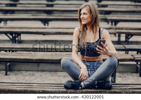 athletic girl running in the Park and doing exercises Jogging - stock photo