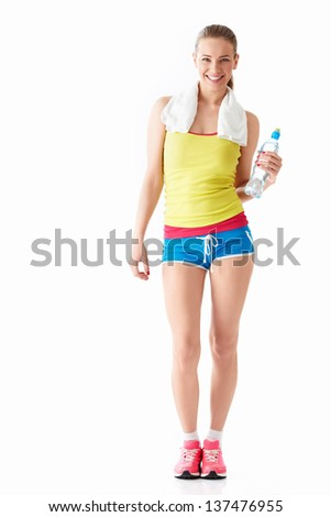 Athletic girl with a bottle of water - stock photo