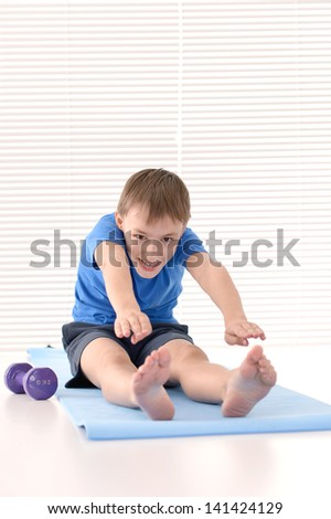athletic guy in a blue shirt on a light background - stock photo