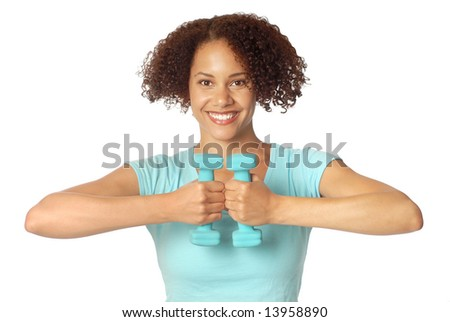 Athletic, healthy, smiling young woman lifting small weights - stock photo