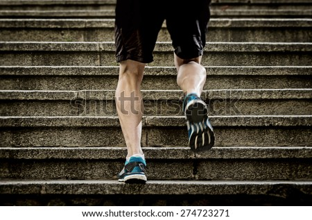 athletic legs of young sport man with sharp scarf muscles running on staircase steps jogging in urban training workout or runner competition in fitness and healthy lifestyle concept - stock photo