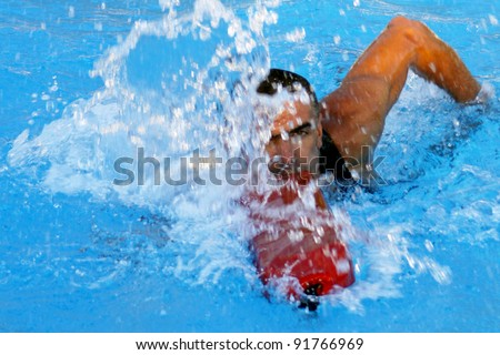 Athletic lifeguard in rescue swimming - stock photo