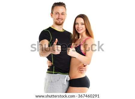 Athletic man and woman after fitness exercise with thumb up on the white background - stock photo