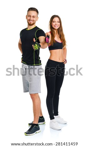 Athletic man and woman after fitness exercise with thumbs up on the white background - stock photo