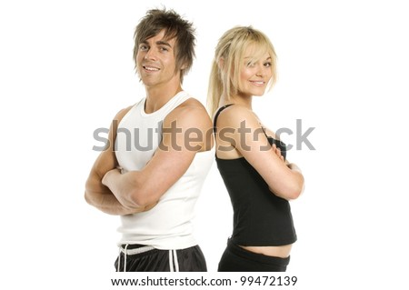 Athletic man and woman in gym wear smiling isolated on a white background - stock photo