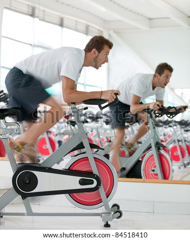Athletic man at the gym - stock photo