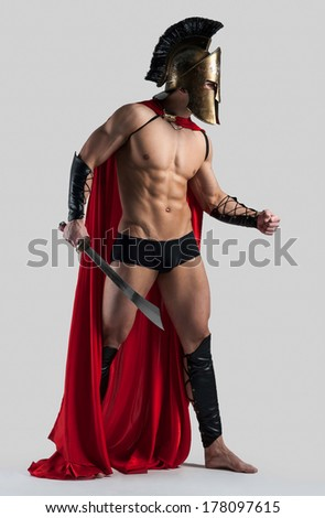 Athletic man in a suit of Spartacus - stock photo
