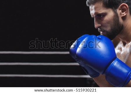 Athletic man in boxing gloves