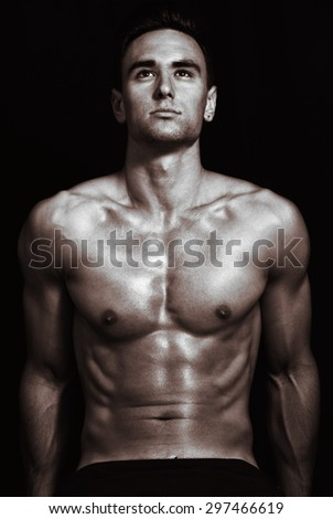 athletic man in the gym - stock photo