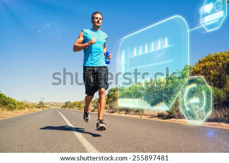 Athletic man jogging on open road holding bottle against fitness interface - stock photo