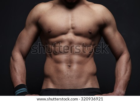 Athletic man on black background