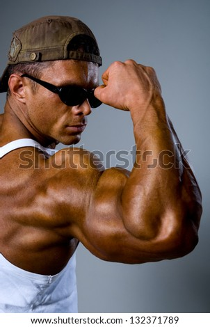 Athletic man showing his muscles. - stock photo