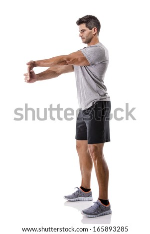 Athletic man stretching arms, isolated over a white background - stock photo