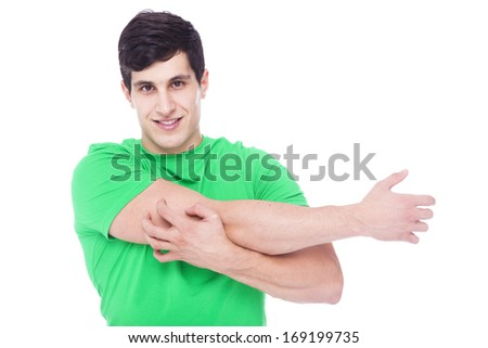 Athletic man stretching the arms, isolated over a white background - stock photo