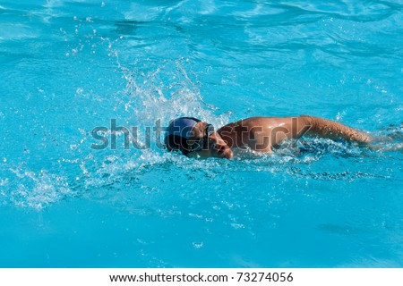 Athletic man swimmer swimming in pool - stock photo