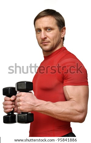 Athletic man with a dumbbells over white - stock photo
