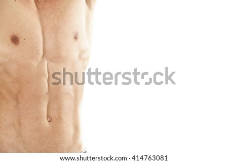 athletic man with abdominal and pectoral isolated on white