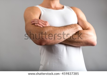 Athletic man with crossed arms
