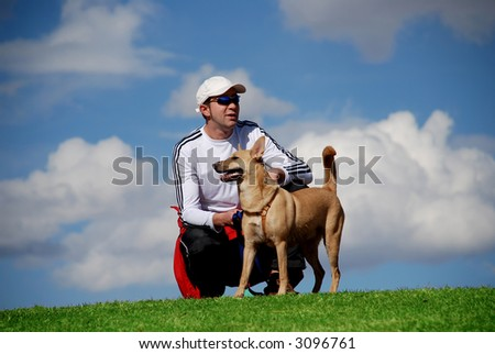 athletic man with his dog - stock photo