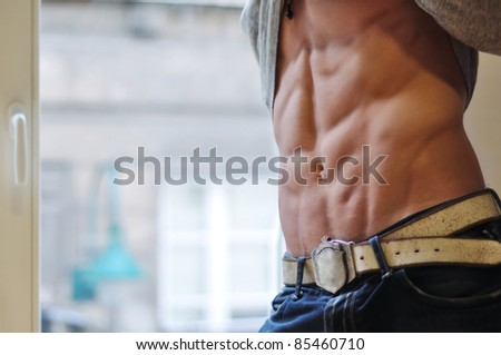 Athletic man with six-pack abs - stock photo