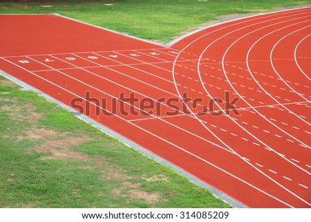 athletic outdoor running track at start point by aerial view - stock photo