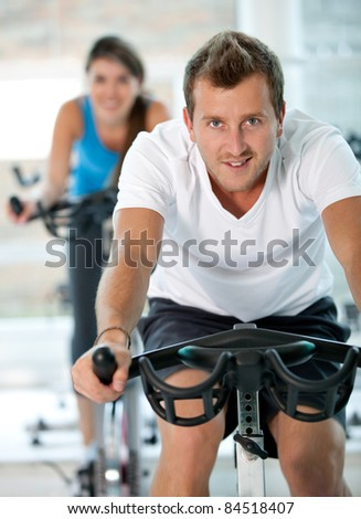 Athletic people at the gym - stock photo