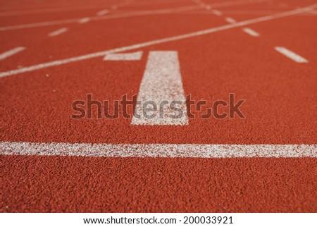 Athletic running track in stadium - stock photo