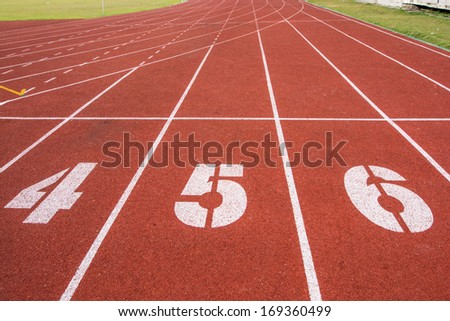 Athletic running track with number four,five and six in stadium - stock photo