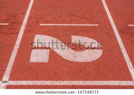 Athletic running track with number  two - stock photo