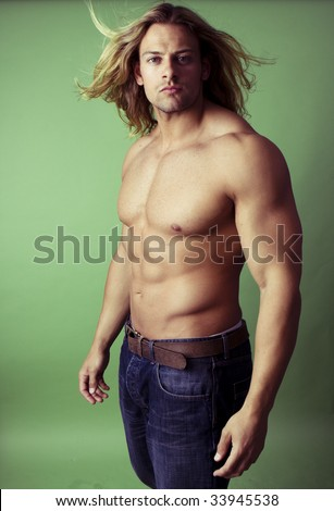 athletic sexy male body builder with the blonde long hair - stock photo