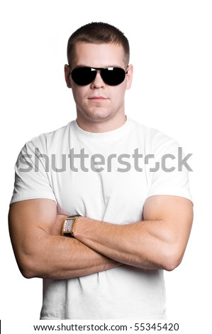 Athletic sexy strong  man in sunglasses isolated on white