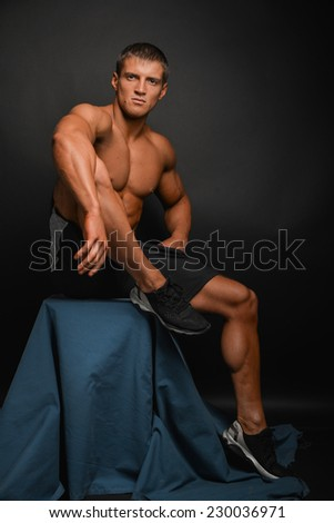 athletic shirtless male model in sport shoe - stock photo