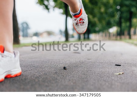 Athletic step in the move. Blurred background - stock photo