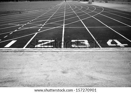 athletic track black and white - stock photo