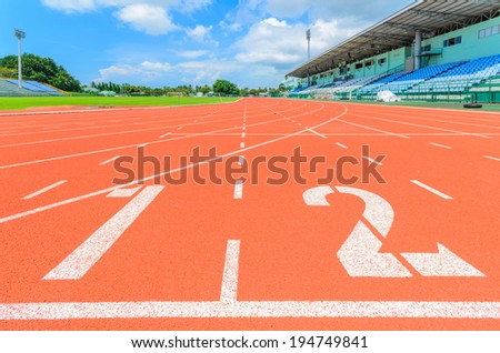 Athletic track with white  line - stock photo