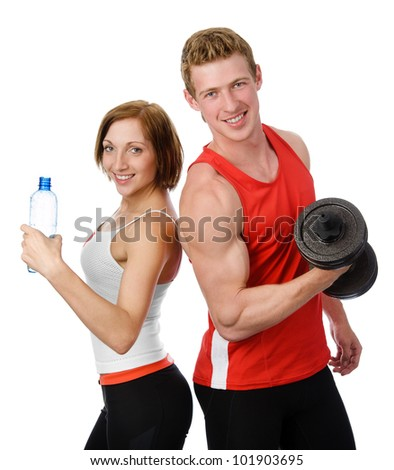 Athletic woman and  man with a dumbells.  isolated on white background - stock photo