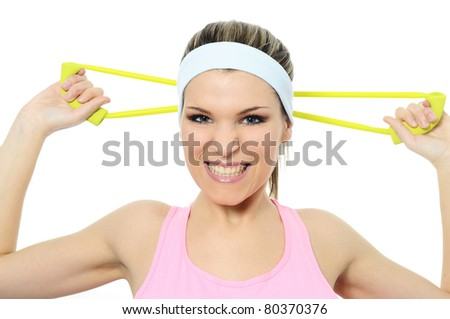 athletic woman doing gymnastic exercises with an elastic fitness - stock photo