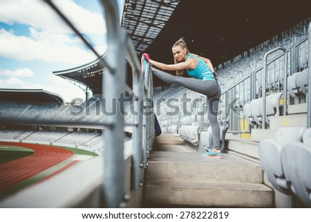 Athletic woman going for a jog or run at running track. Healthy fitness concept - stock photo