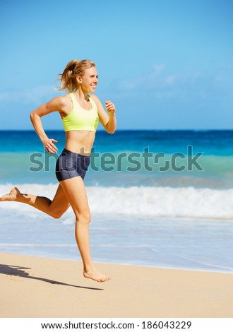 Athletic Woman Running on the Beach. Female Runner Jogging. Outdoor Workout.  - stock photo