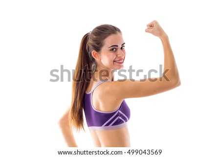 Athletic woman showing her biceps